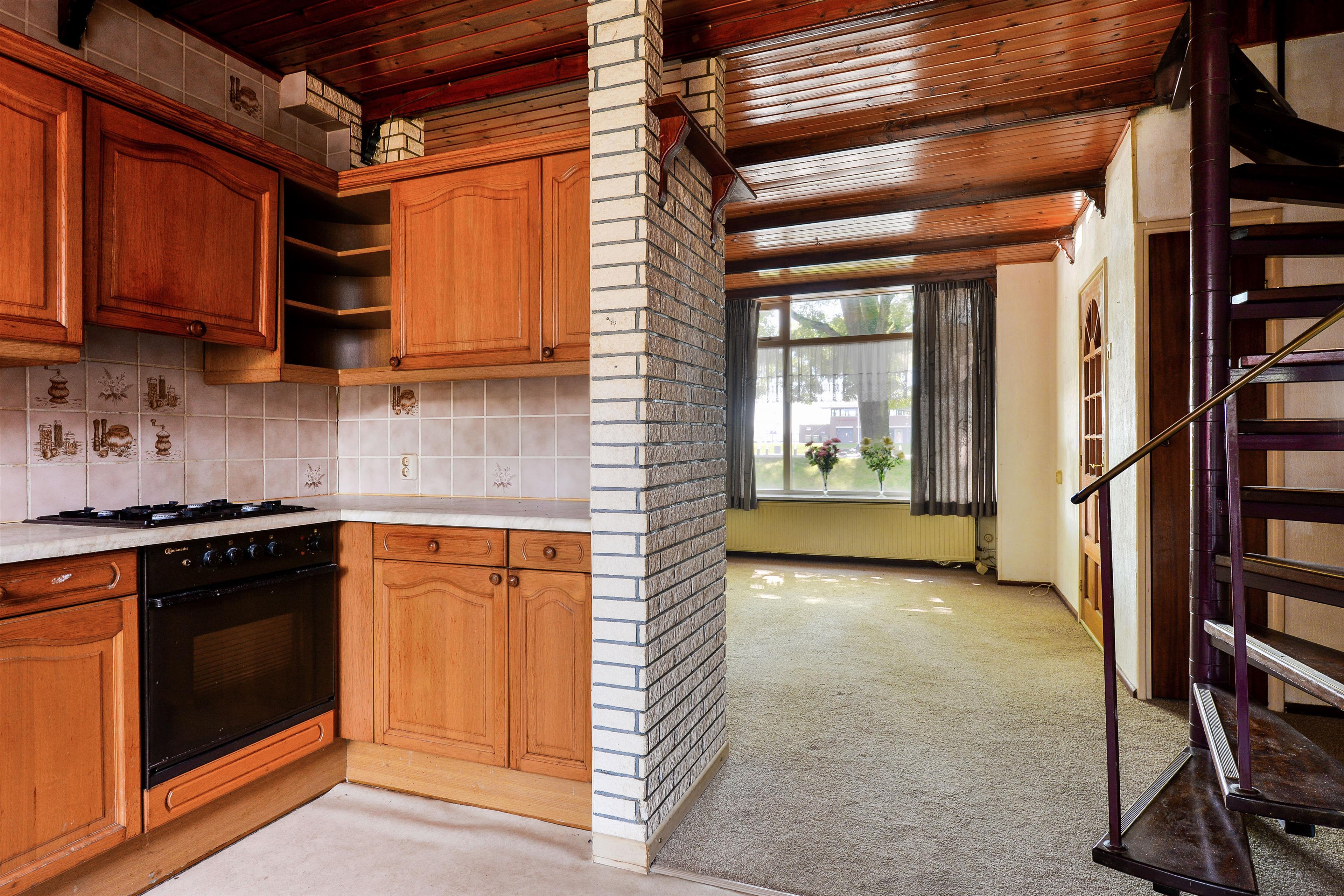 Wat Is Een Half Open Keuken : De half open keuken heeft toegang tot het terras en de achtertuin. In